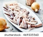 Stock photo close up of sliced herring fillets with cutted into shreds onion marinated in vinegar on white 469335560