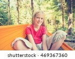 smiling girl sitting in a... | Shutterstock . vector #469367360
