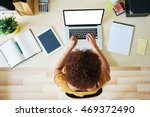 young woman working from home | Shutterstock . vector #469372490