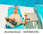 woman relaxing at the poolside...   Shutterstock . vector #469384196
