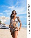 long haired girl in bikini on... | Shutterstock . vector #469389380