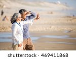 mid aged couple laying out on... | Shutterstock . vector #469411868