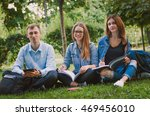 happy students sit on the grass ...   Shutterstock . vector #469456010
