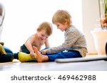 boys sitting on the floor... | Shutterstock . vector #469462988