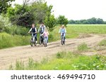 happy family riding bikes on... | Shutterstock . vector #469494710