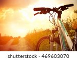 bicycle on the field road | Shutterstock . vector #469603070
