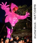 Small photo of UBUD, INDONESIA - CIRCA MARCH 2008: Demon statue being carried in the Oga-oga parade after dark