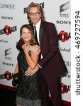 Small photo of NEW YORK-AUG 3: Musician Rick Springfield (R) and wife Barbara Porter attend the 'Ricki And The Flash' New York premiere at AMC Lincoln Square Theater on August 3, 2015 in New York City.