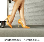 woman legs and sofa in home  | Shutterstock . vector #469865513