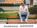 hipster with man bun sitting on ...   Shutterstock . vector #469952909