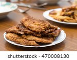 Breaded Steaks Served With...