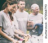 happy volunteer looking at... | Shutterstock . vector #470068793