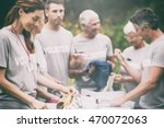 happy volunteer looking at... | Shutterstock . vector #470072063