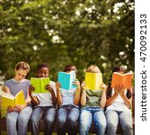 children reading books at park... | Shutterstock . vector #470092133