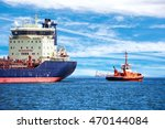 Tugboat Towing A Large Ship On...