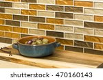 Stock photo contemporary home kitchen interior olives appetizers in glazed clay ceramic serving dish on 470160143