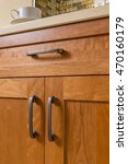 Stock photo close up detail of high quality cherry wood cabinets with bronze cabinet hardware in contemporary 470160179