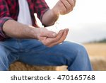 farmer and harvest. closeup of... | Shutterstock . vector #470165768