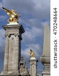 Small photo of June 23, 2016 - Paris, France. Two of the four 17-metre masonry socles that support four gilt-bronze statues of Fames, Pont Alexandre III (Alexander III Bridge).