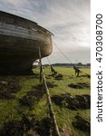 Small photo of A color image of a wrecked boat aground at low tide in the south of England