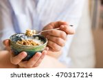 young woman with muesli bowl.... | Shutterstock . vector #470317214