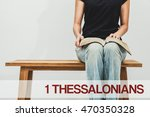 Small photo of A woman reading the book bible of 1 Thessalonians