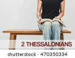 Small photo of A woman reading the book bible of 2 Thessalonians