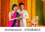 happy indian family celebrating ... | Shutterstock . vector #470384810