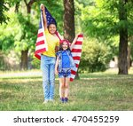 boy and girl holding american... | Shutterstock . vector #470455259