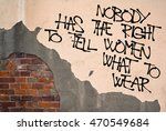 Small photo of Nobody Has The Right To Tell Women What To Wear - Handwritten graffiti sprayed on the wall, anarchist aesthetics -freedom and emancipation of clothing. Fight against oppressive norms of obscenity