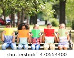 cute kids reading books on bench | Shutterstock . vector #470554400