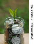 plant growing out of coins   Shutterstock . vector #470565758