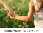 parent and child holding hands... | Shutterstock . vector #470575214