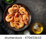 plate of fried prawns on dark... | Shutterstock . vector #470653610