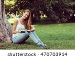 young woman sitting on the... | Shutterstock . vector #470703914