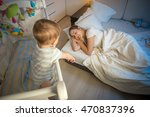 Baby In Cot Crying And Trying...