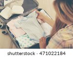pregnant woman packing suitcase ... | Shutterstock . vector #471022184