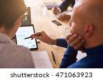 mature businesswoman holding a... | Shutterstock . vector #471063923