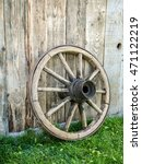 Old Wooden Wagon Wheel Resting...