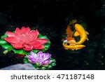 Koi Fish And Flowers On A Pond