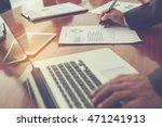 Small photo of Close-up shot of an analytical working with the latest financial results Financial accounting sales forecast graphs analysis with hand writing , digital effect abstract for background