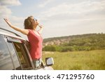 beautiful girl traveling by car | Shutterstock . vector #471295760