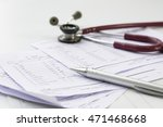 stethoscope and  pen put on a