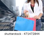 woman holding shopping bag and