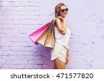 pretty young woman holding... | Shutterstock . vector #471577820