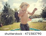 Cute Little Boy In Straw Hat Is ...