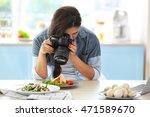 girl photographing on kitchen.... | Shutterstock . vector #471589670