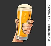 male hand holding a beer glass. ... | Shutterstock .eps vector #471700250