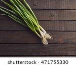 fresh leeks on wooden table....