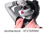 Beauty Fashion model girl black and white portrait, wearing stylish sunglasses. Sexy woman portrait with perfect makeup and manicure, trendy accessories and fashion wear. Beauty trends